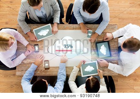 business, people, cloud computing and technology concept - close up of creative team with smartphones and tablet pc computers uploading data to server at office