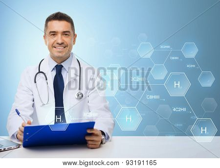 medicine, profession, technology and people concept - happy male doctor with clipboard and stethoscope over blue background with hydrogen chemical formula