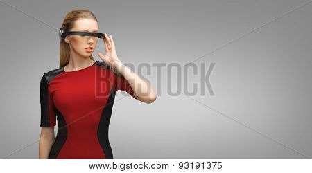 people, technology, future and progress - young woman with futuristic 3d glasses over gray background