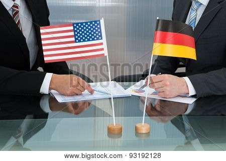 Close-up Of American And German Businessman