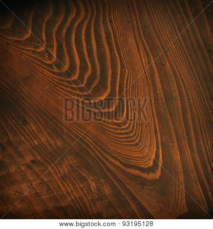 Old grungy wooden surface texture with bold grains. Surface has scratches and dents.