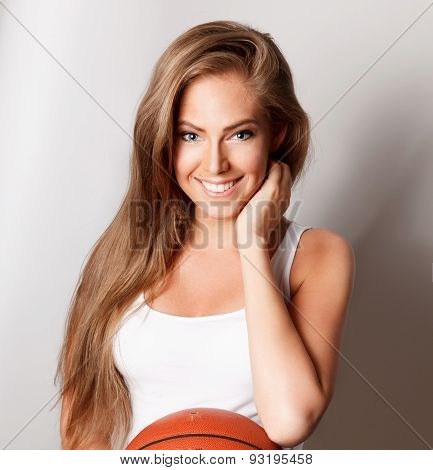 Beautiful Happy Woman With A Basketball