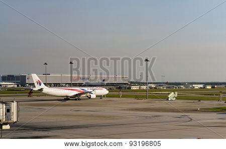 KUALA LUMPUR, MALAYSIA - MAY 06, 2014: jet aircraft in the airport. Kuala Lumpur International Airport (KLIA) is Malaysia's main international airport and one of the major airports of South East Asia