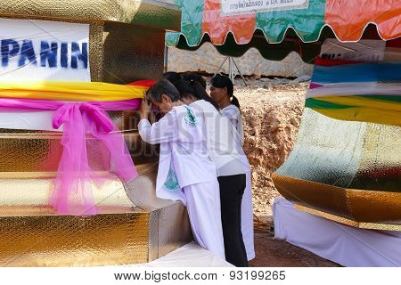 People Hold Colorful Cloth Around The Pagoda Structure Which Is The Buddhist Culture