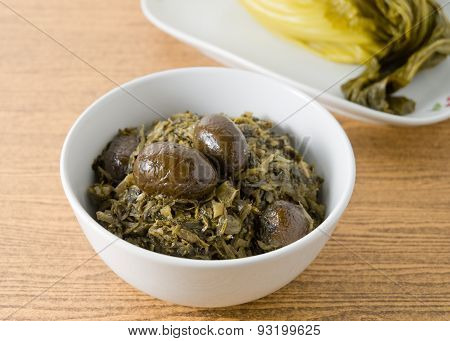 A Bowl Of Chopped Pickled Green Cabbage