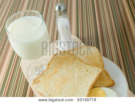Brown Toast With Boiled Eggs And Milk For Breakfast