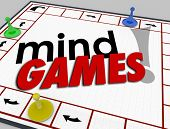 Постер, плакат: Mind Games words on a board game to illustrate pscyhology behavior tricks psychology and emotion