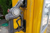 picture of dispenser  - old fuel nozzle dispenser for adding gasoline - JPG