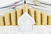 stock photo of piles  - Close up house on finance account have step pile of gold coins and pile of paperwork as background - JPG