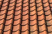 stock photo of red roof  - Red roof tile pattern over blue sky - JPG