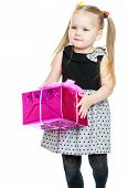 stock photo of ponytail  - Adorable little girl with long ponytails on her head holding a beautifully wrapped gift-Isolated on white background ** Note: Soft Focus at 100%, best at smaller sizes - JPG