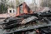 stock photo of abandoned house  - Remains of the old abandoned ruined house - JPG
