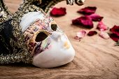 stock photo of venetian carnival  - Close up carnival venetian mask on wooden background - JPG