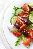 stock photo of endive  - Tomato and cucumber salad with endive and olives - JPG