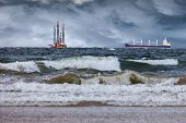 stock photo of rig  - Oil Rig with ship at sea during a storm - JPG