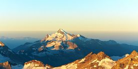 picture of mountain-range  - scenic alpine landscape with and mountain ranges - JPG
