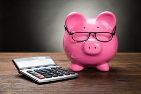 image of calculator  - Pink Piggybank With Calculator On Wooden Table - JPG