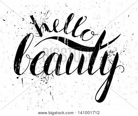 Grunge handwritten calligraphic ink inscription Hello beauty on white background with splatters.