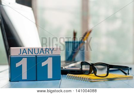 January 11th. Day 11 of month, calendar on Software Engineer workplace background. Winter concept. Empty space for text.