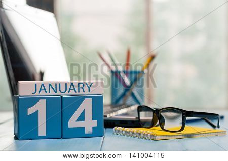 January 14th. Day 14 of month, calendar on Engineer workplace background. Winter time. Empty space for text.