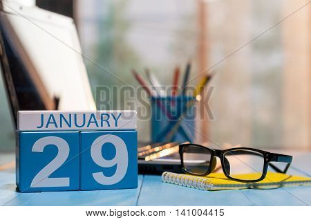 January 29th. Day 29 of month, calendar on editor workspace background. Winter at work concept. Empty space for text.