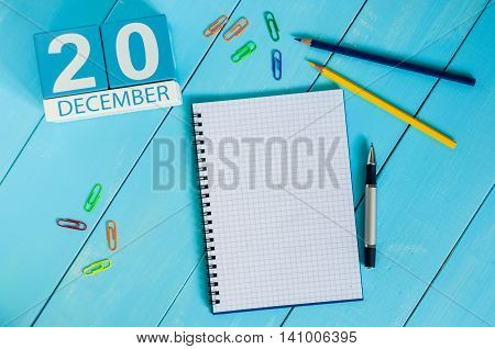 December 20th. Day 20 of month, calendar on freelancer workspace background. Winter time. Empty space for text.