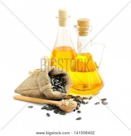 Wooden Spoon With Sunflower Seeds On A Background Of Small Bag And A Bottles Of Oil