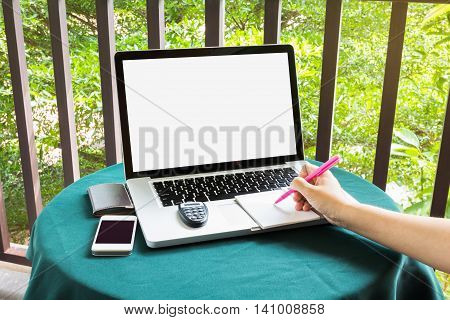 Hand Writing Down On Paper Pad With Blank Screen Notebook