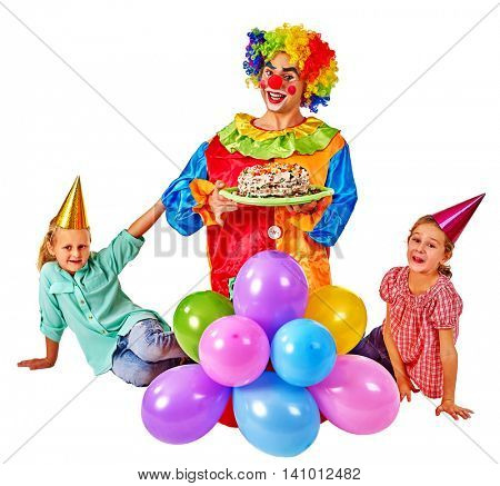 Clown keeps cake on birthday with two children . Birthday decoration with balloons. Isolated.
