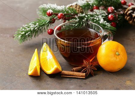 cup of tea with anise, cinnamon and citrus fruits winter drink, Christmas decorations