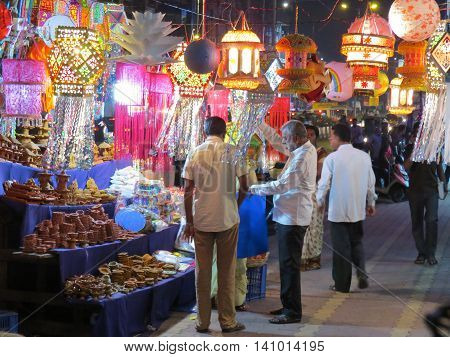 Pune, India - October 29, 2013: People shopping for lanterns and other traditional items on occassion of Diwali festival in India