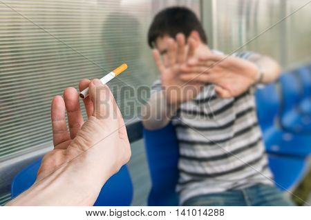 Man is quitting smoking and is refusing cigarette offer.
