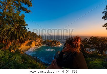 Tourist Looking At Mcway Falls Big Sur California