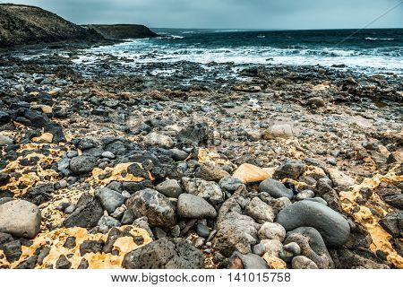 black hardened lava stones on Lanzarote seashore, Spain