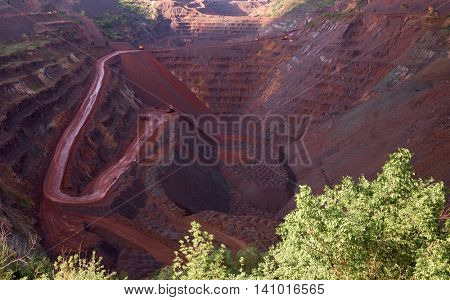 view inside the iron oxid quarry with trails on slopes in Krivyi Rih, Ukraine