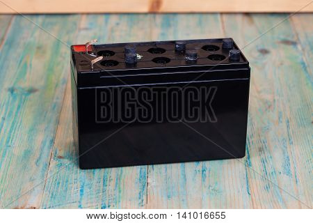 Open Sealed battery on wood background Seletive focus