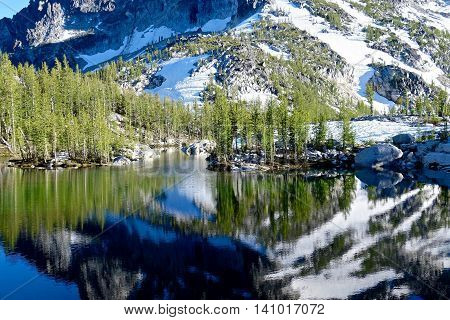 Reflection in alpine lake. Enchantment lakes basin near Leavenworth and Seattle North Cascades WA.