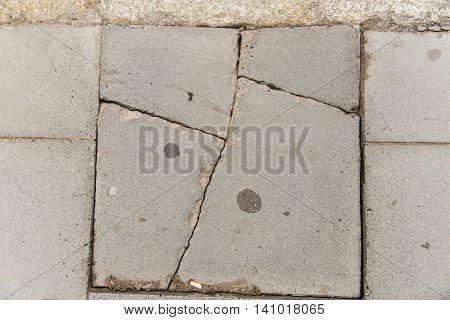 masonry and stonework concept - close up of cracked stone plate