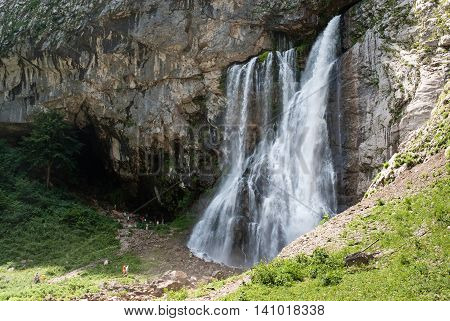 Waterfall flowing from a rock in the mountains of Abkhazia