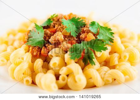 Pasta served with bolognese sauce. Traditional Italian food. Close-up very shallow depth of field