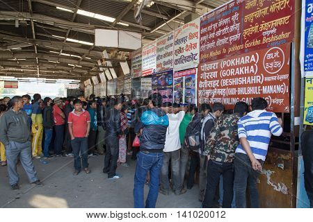 Kathmandu, Nepal - October 22, 2014: People waiting in line at the ticket booth at the bus station