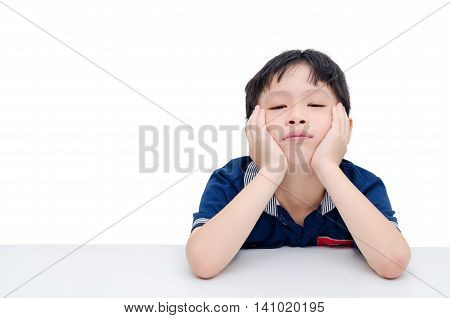 Boring Asian boy sitting over white background