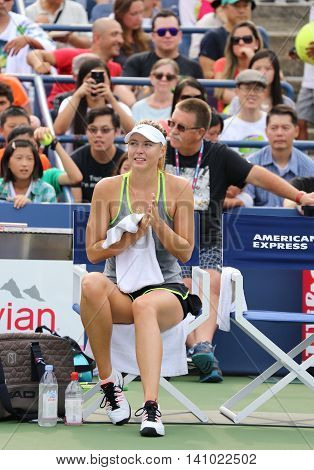 NEW YORK - AUGUST 30, 2015:Five times Grand Slam Champion Maria Sharapova practices for US Open 2015 at National Tennis Center. Few hours later Maria withdraws from US Open with leg injury.