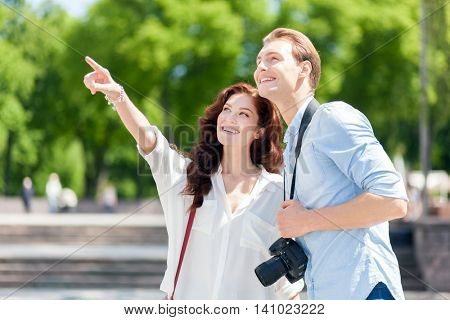 Couple of tourists taking picture in the city