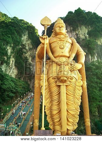 Entrance of the Batu Caves, Kuala Lumpur. Famous place in Malaysia, golden statue.