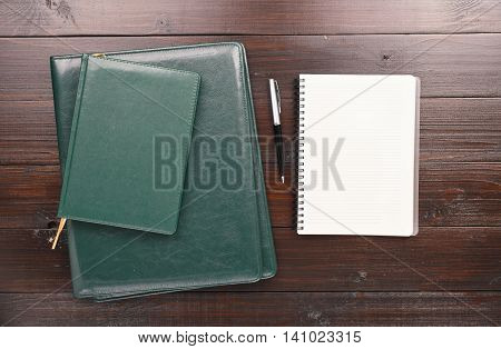 On the Office Desk Is Open Notebook With Blank Pages Pen Diary And Leather Business Folder. Top view. Business Background