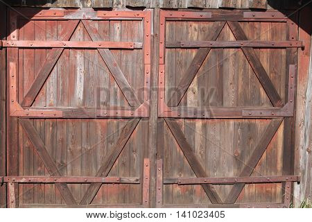 solid gate in ancient style from wood tight close entrance into garage