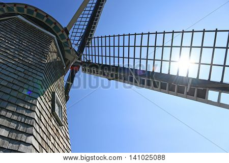 Close up view of windmill in Holland Michigan with sun shinning through blade