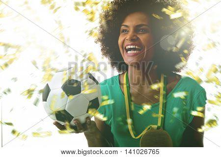 Female Brazilian athlete celebrating