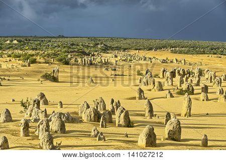 Pinnacles under a stormy sky in the desert of Nambung National Park Western Australia Australia